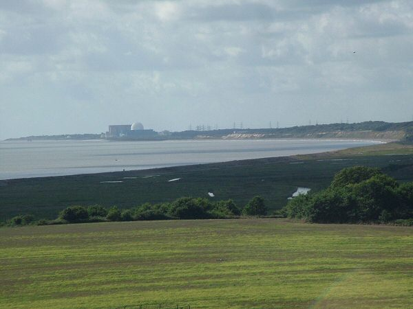 9: Zooming in from the last view we can clearly see the sweep of the bay between Walberswick and Thorpeness. The ugly building ruining this view is Sizewell Power Station. In the middle of the picture are the extensive marshes which are now a nature reserve with a wealth of birds and wildlife. You also clearly see Dunwich Cliffs and in the distance on the far left is Thorpeness.